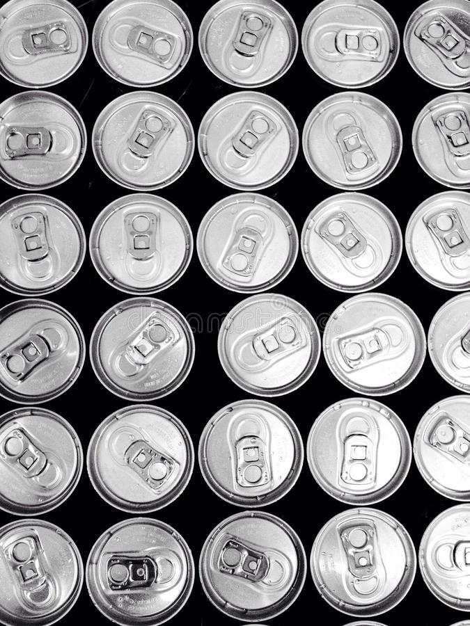 Drinking water in many cans stock image