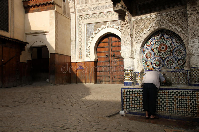Drinking water in the medina royalty free stock images