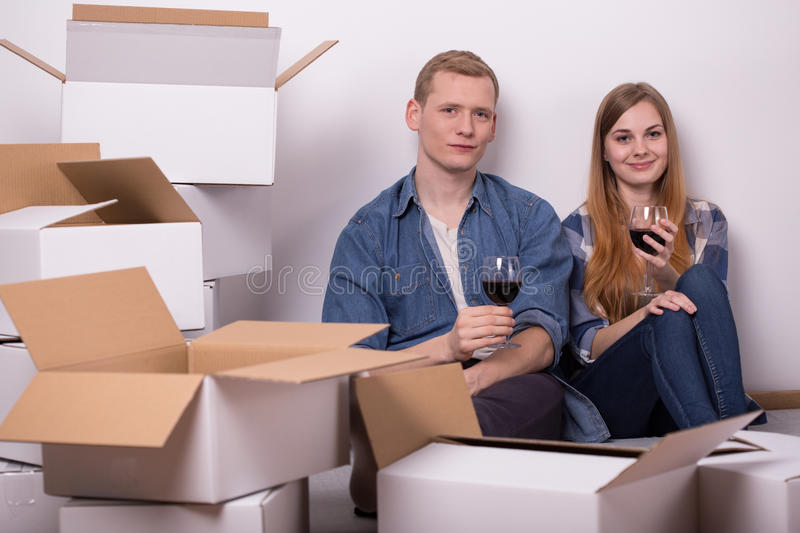 Drinking wine in new house royalty free stock photos