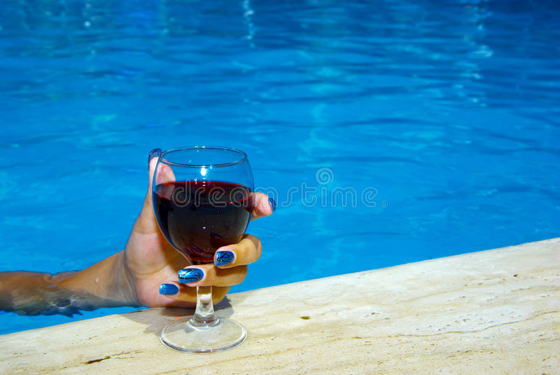 Download Drinking wine in the pool stock photo. Image of human - 10969482
