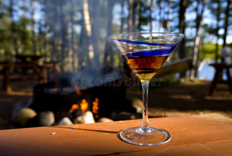 Drinks by the campfire royalty free stock photo