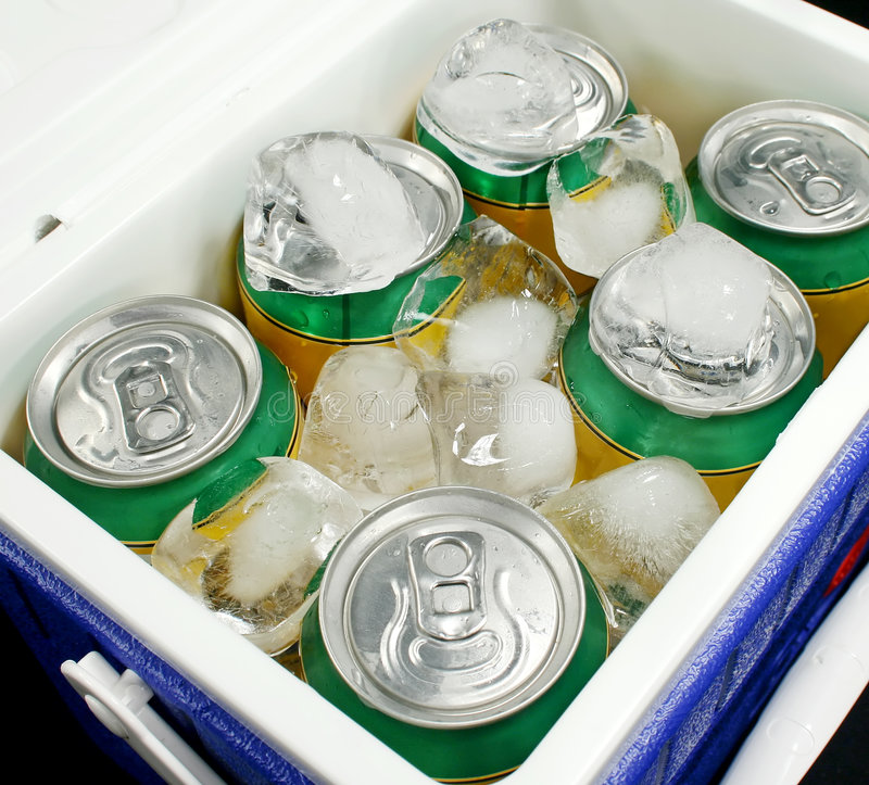 Drinks Cooler. Drink cans covered in ice in a drinks cooler stock photos