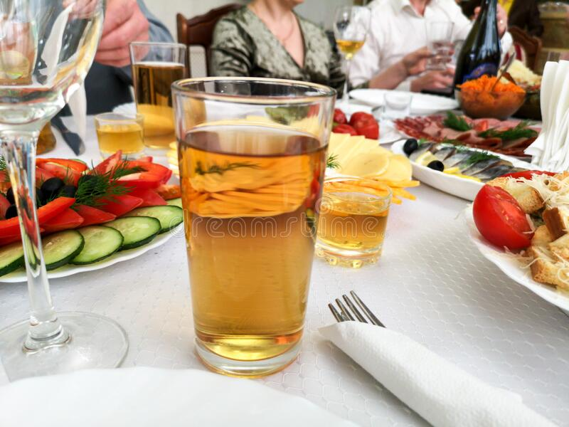Drinks in glasses on the festive table stock photos