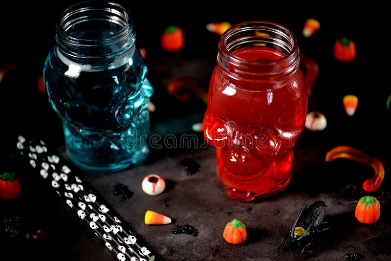 Drinks for the holiday of Halloween in skull-glass. stock photos