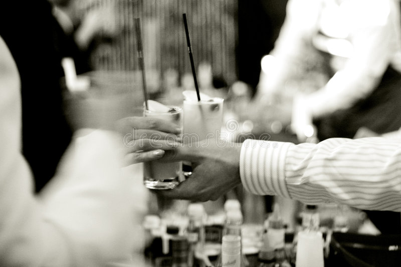 Drinks at the party. Bartender serves a drinks, natural light, high ISO stock photography