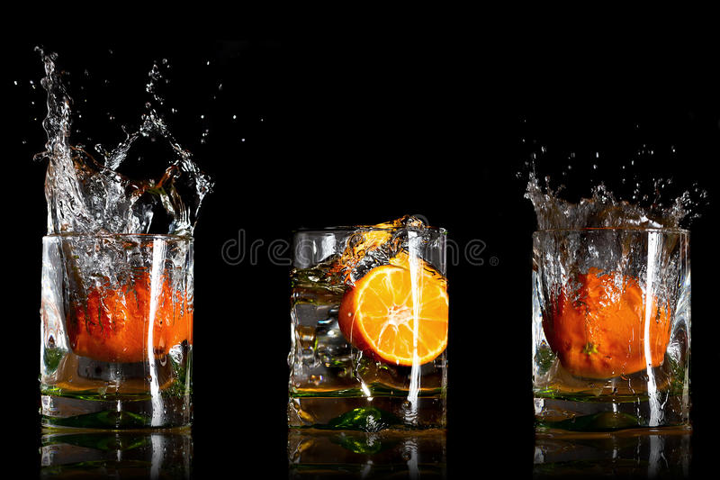 Download Drinks With Splashing Oranges Royalty Free Stock Images - Image: 22525159