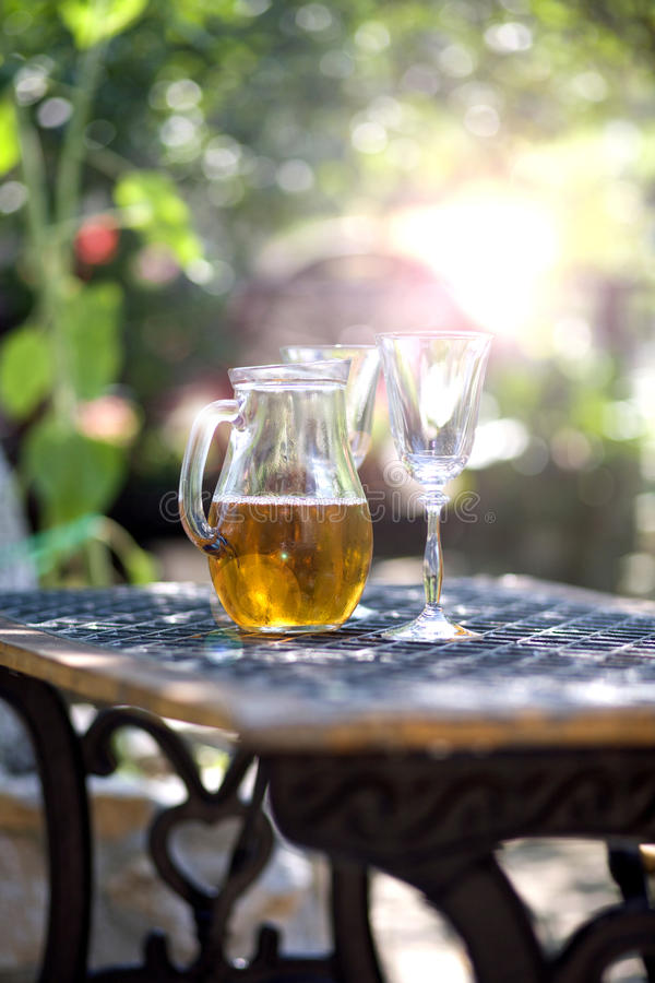 Drinks on table in garden. Wine white royalty free stock image