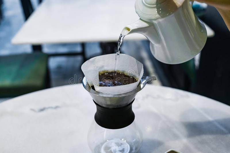 Drip brewing, filtered coffee royalty free stock images