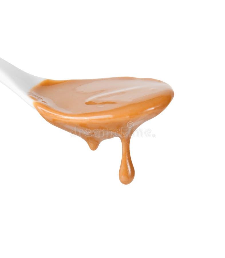 Drip of caramel sauce stock photos