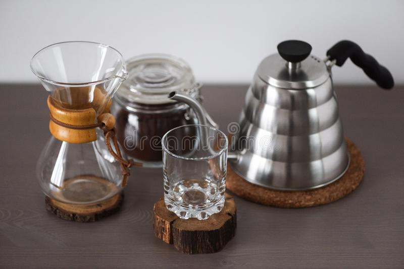 Drip coffee pour over set. Hand drip coffee maker, glass, kettle royalty free stock photography