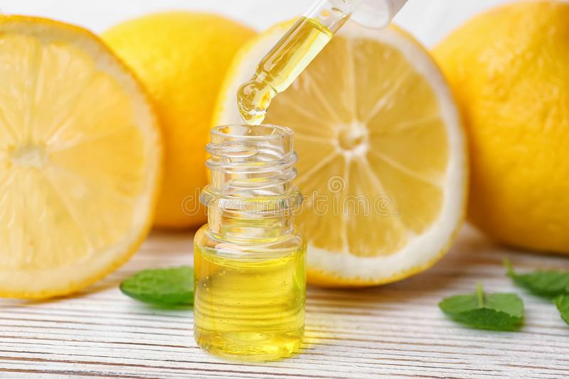 Dripping citrus essential oil into bottle stock image