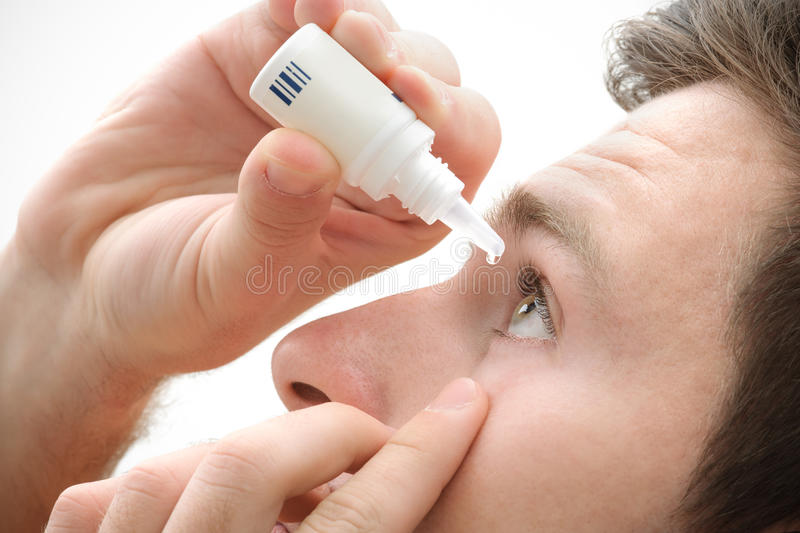 Dripping eye with eyes drops