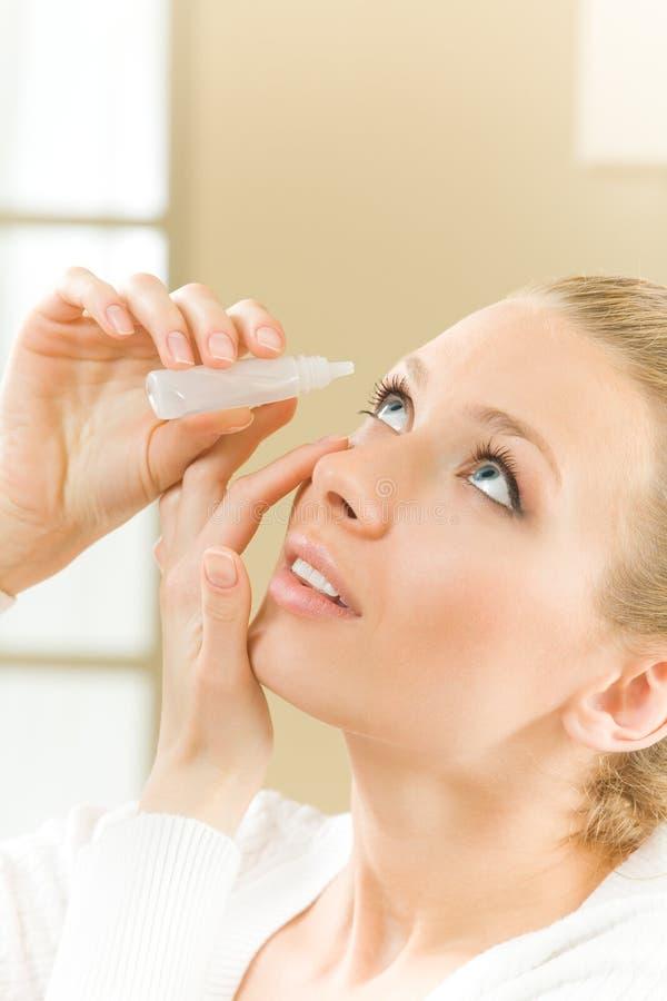 dripping eye woman royaltyfri foto