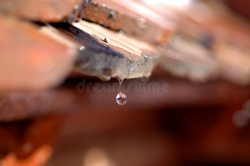 Dripping roof - waterdrops royalty free stock images