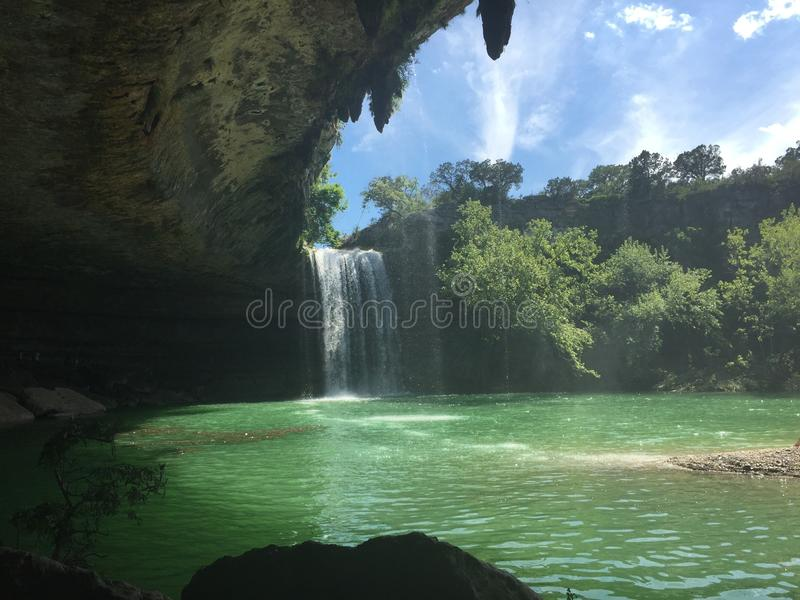 Dripping Springs. Just outside of Austin, Texas has the most spectacular natural sinkhole and waterfall stock image