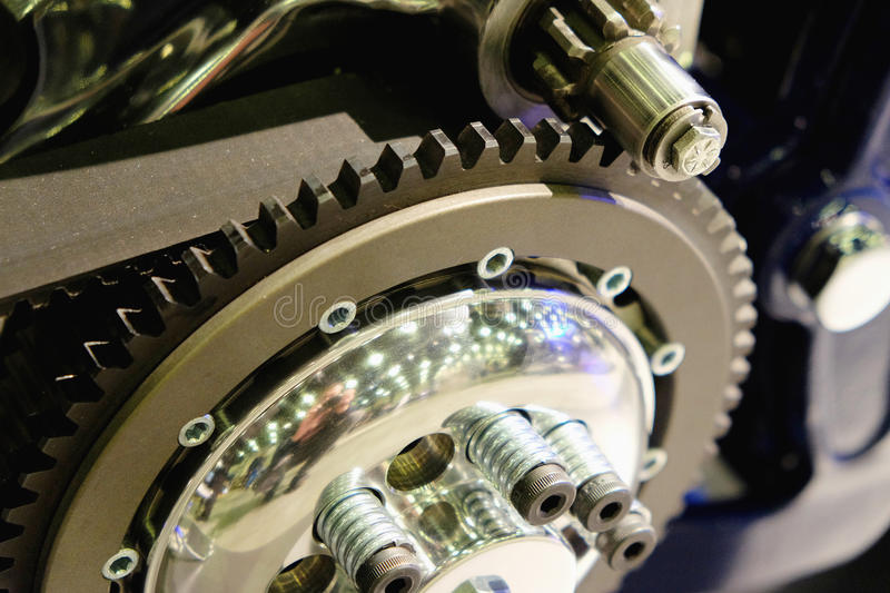 Drive belt on the sprocket. In motorcycle engine stock photo