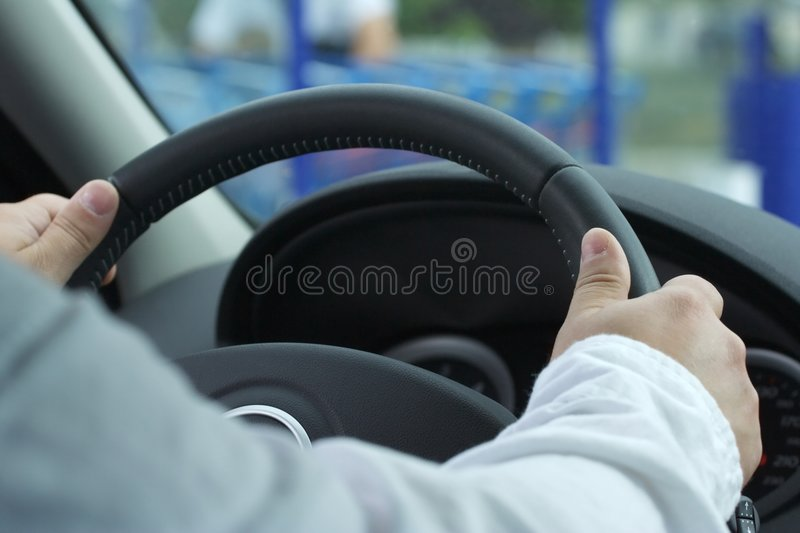 Drive a car with the two hands stock images
