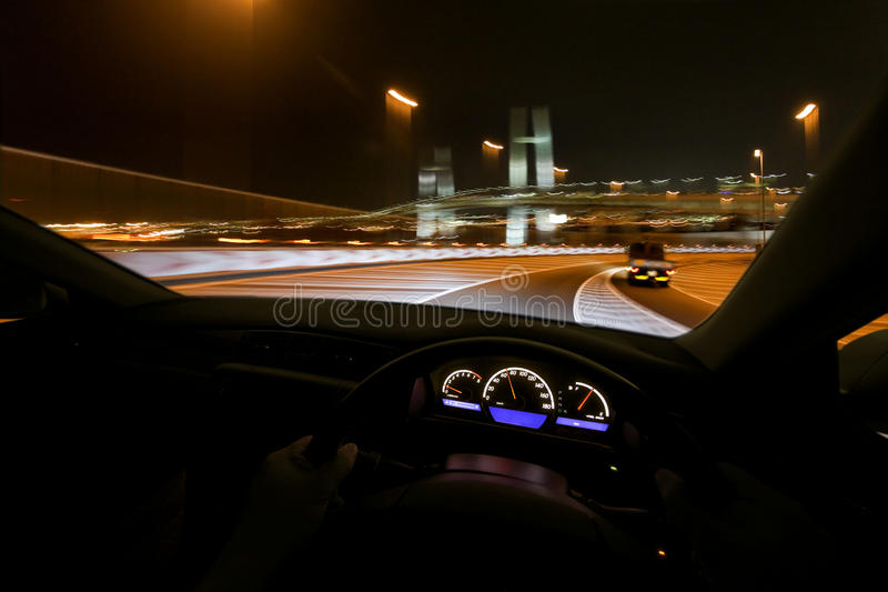 Drive fast at night stock photography