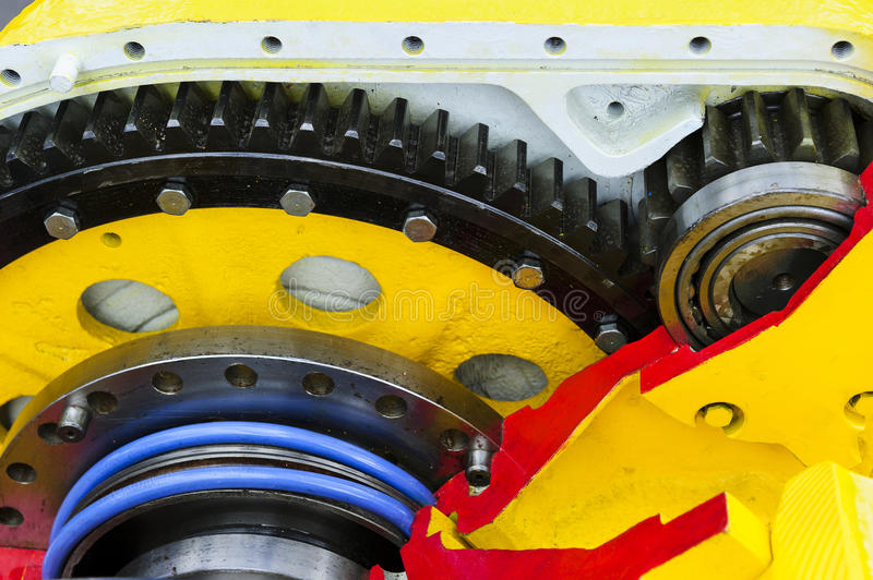 Drive gear and bearings. Cross section of bulldozer sprocket internal mechanism, large construction machine with bolts and yellow paint coating, heavy industry stock photography