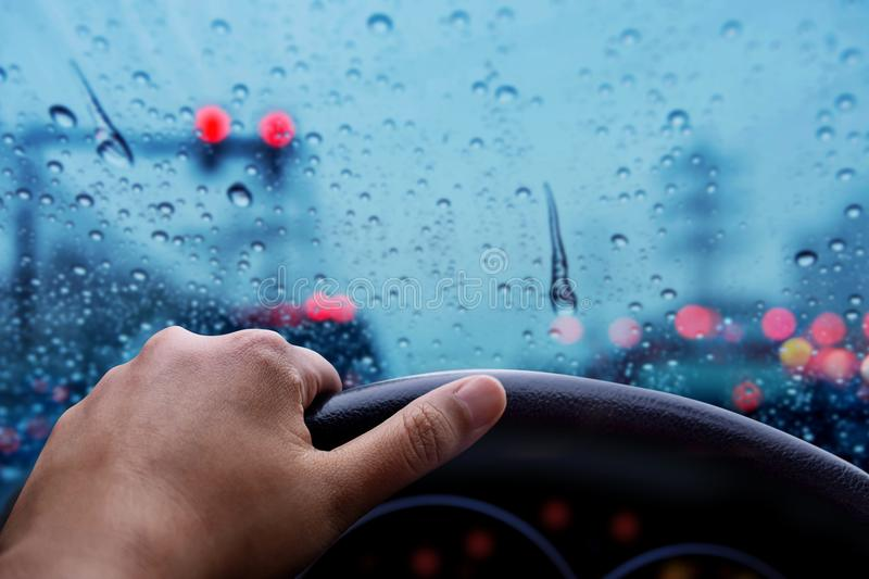 Drive in Rainy Day. Bad Weather on the Road with Blurred Lights royalty free stock image