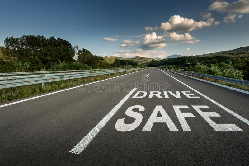 Drive safe message on Asphalt highway road through the countryside stock photos