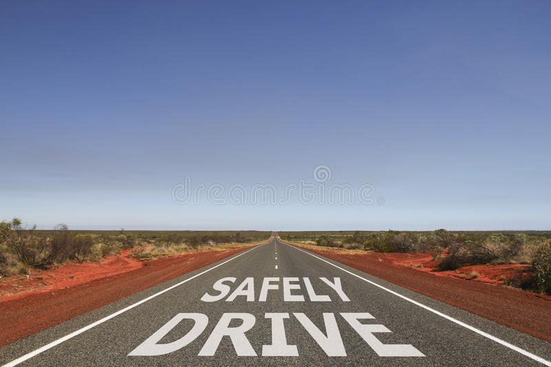 Drive safely written on the road stock photography