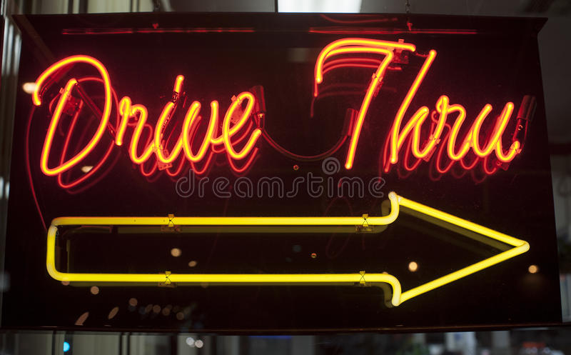 Drive thru neon sign stock photography