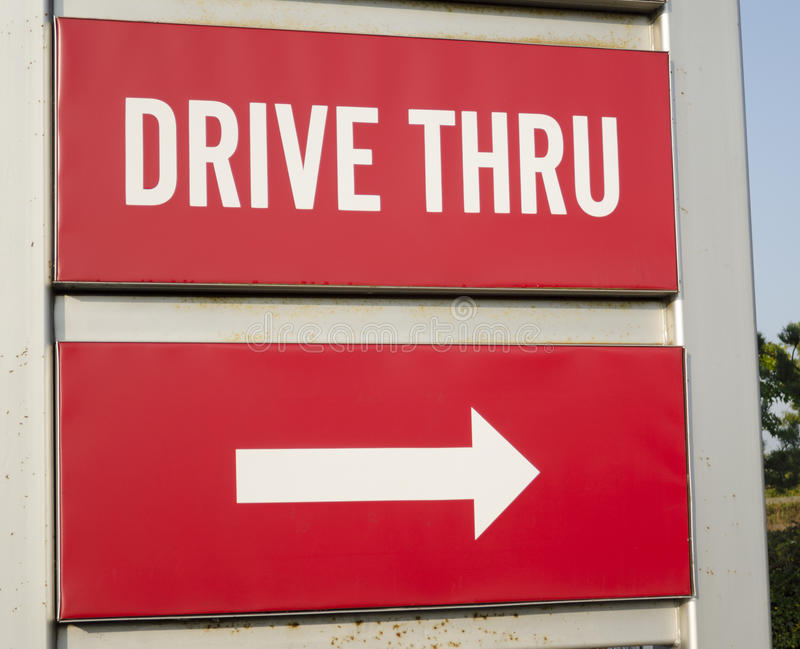 Drive thru road sign royalty free stock photography