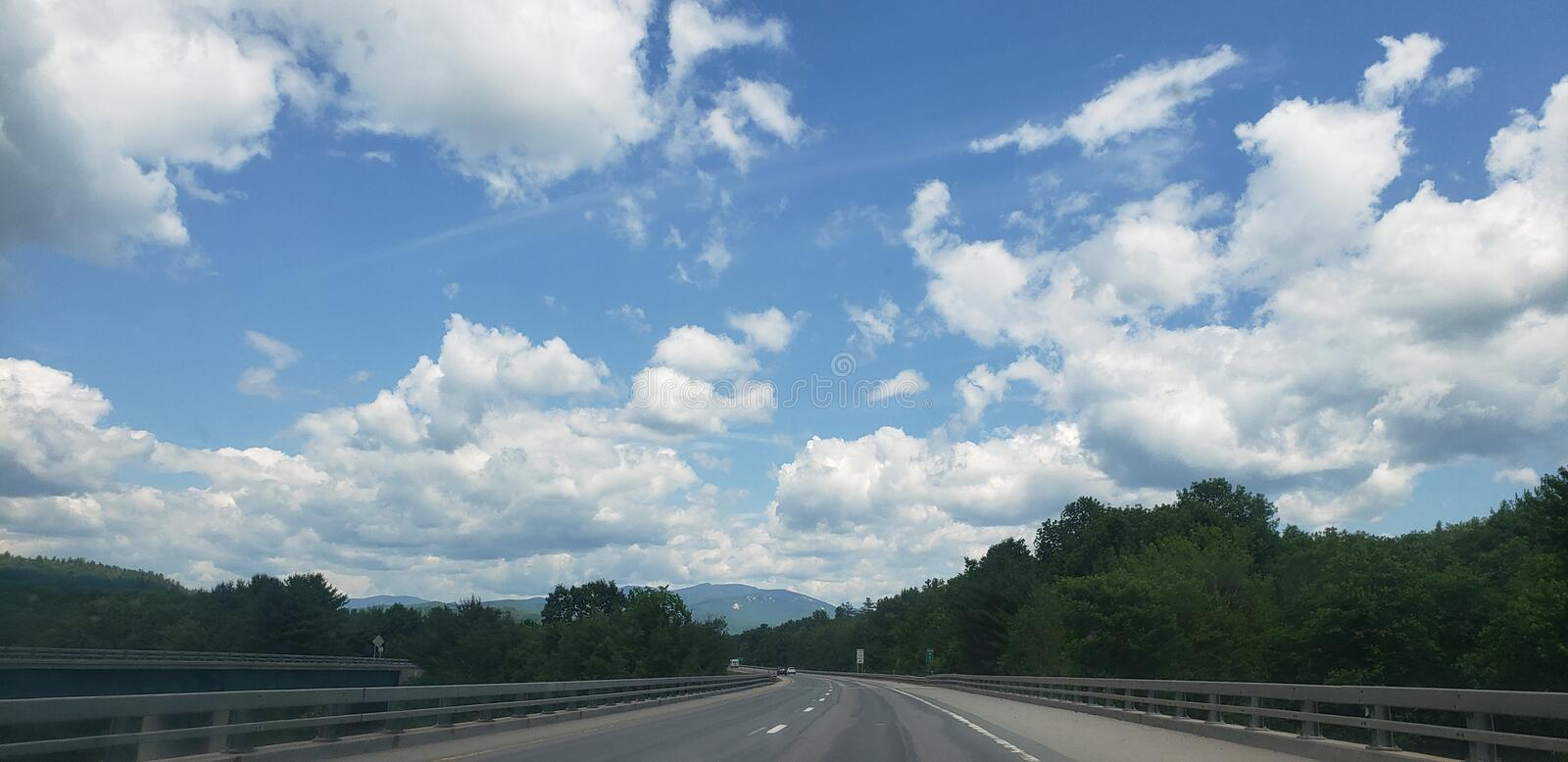 Drive to paradise. Bridge, sky, clouds royalty free stock image