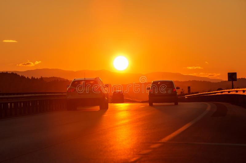 Drive to sunset. Drive at sunset on the highway, going to vacation stock image
