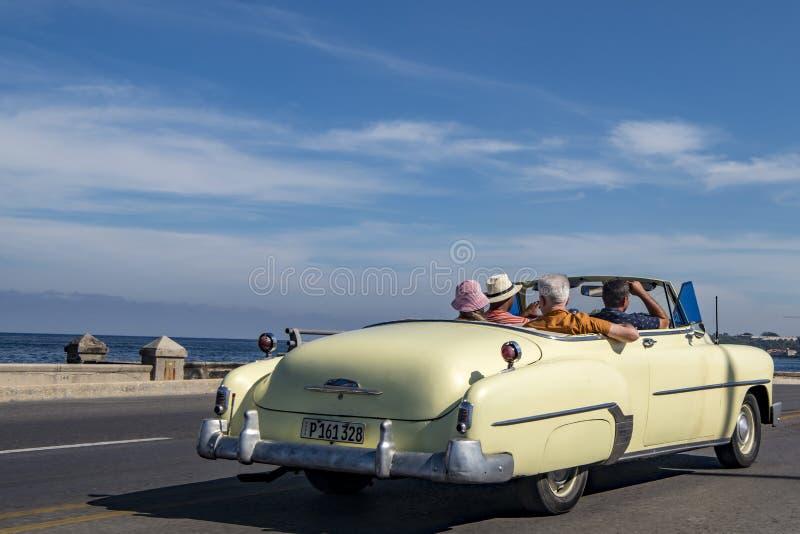 Drive in vintage car over Malecón, Havana, Cuba stock photography