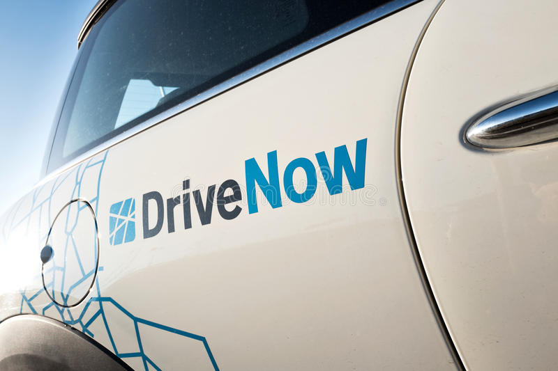 DriveNow carsharing MINI. DriveNow is a joint venture between BMW and Sixt that provides carsharing services in several European cities stock images