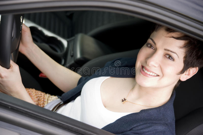 Download Female Driver Seated In Black Sport Sedan Auto Stock Images - Image: 25295644