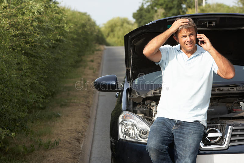 Driver Broken Down On Country Road Royalty Free Stock Photography