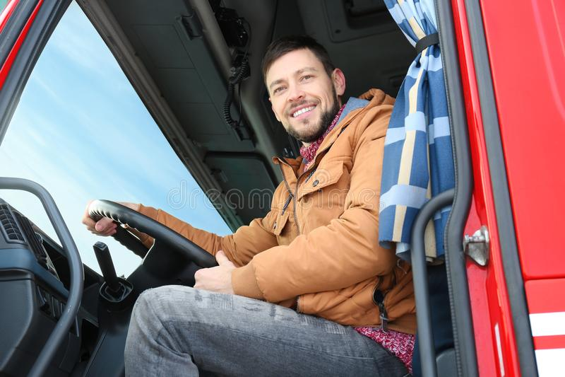 Driver in cabin of big truck. Driver in cabin of big modern truck stock images