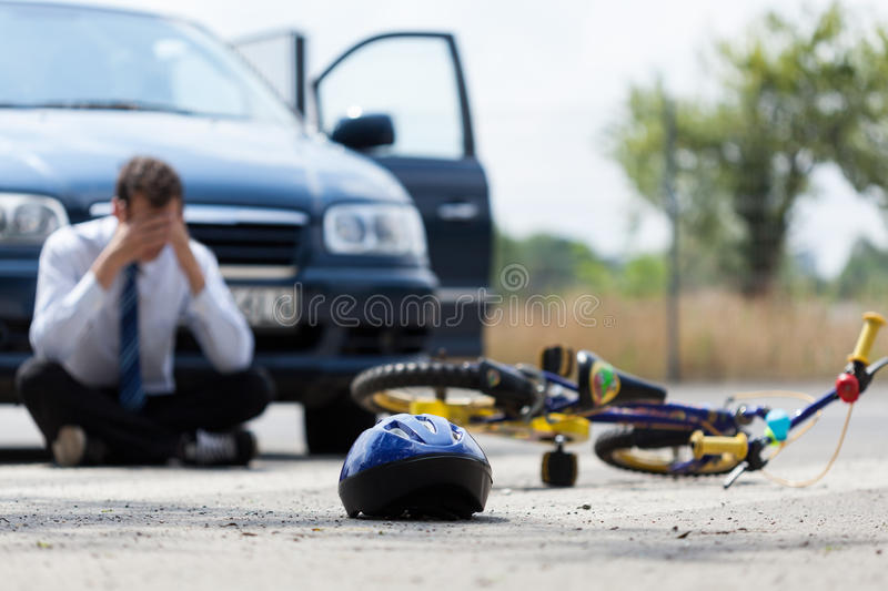 Driver after car accident. Driver sitting on the street after car accident royalty free stock photo