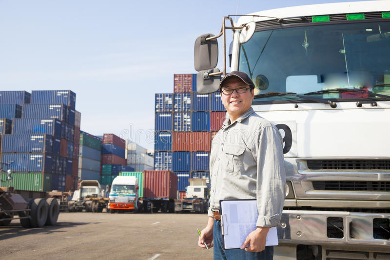 Driver in front of container truck. Happy driver in front of container truck stock photo