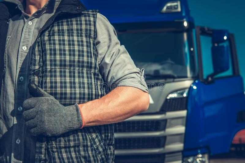 Driver in Front of Truck. Caucasian Driver in Front of His Truck. Transportation Industry stock image