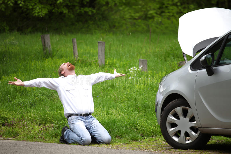 Driver furious a broken car. By the road royalty free stock photography