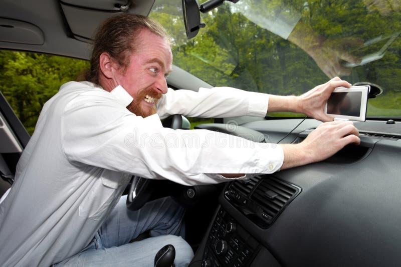 Driver furious on GPS navigation stock photo