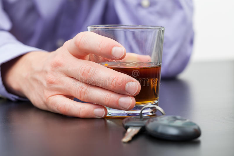 Driver with glass of whisky stock photography