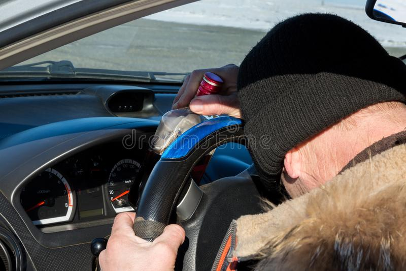 The driver got drunk liquor and fell asleep in the car. stock photos