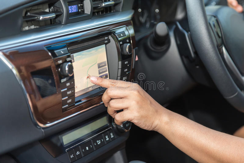 Driver hand press navigation screen in the car royalty free stock photos
