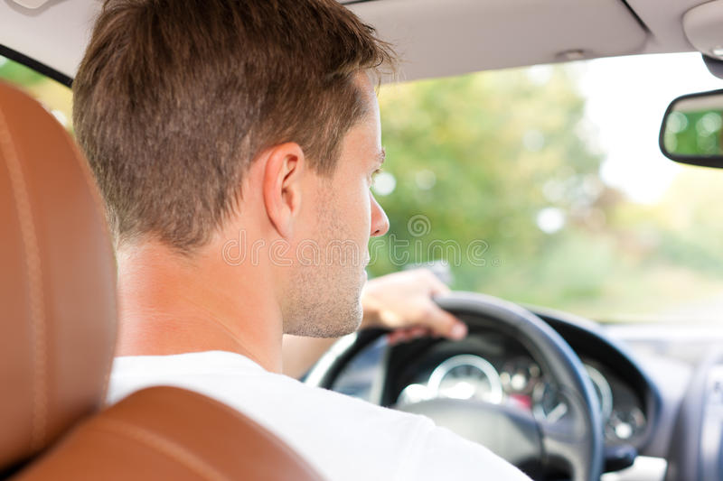 Driver in his car or van. Driver is sitting in his car or van and is driving stock photography