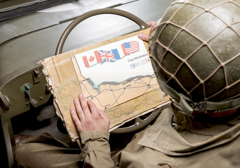 Driver of a military vehicle look at a map of Normandy. For the 70th anniversary royalty free stock images