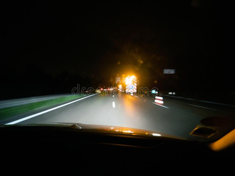 Driver POV at the dark highway with accident stock images
