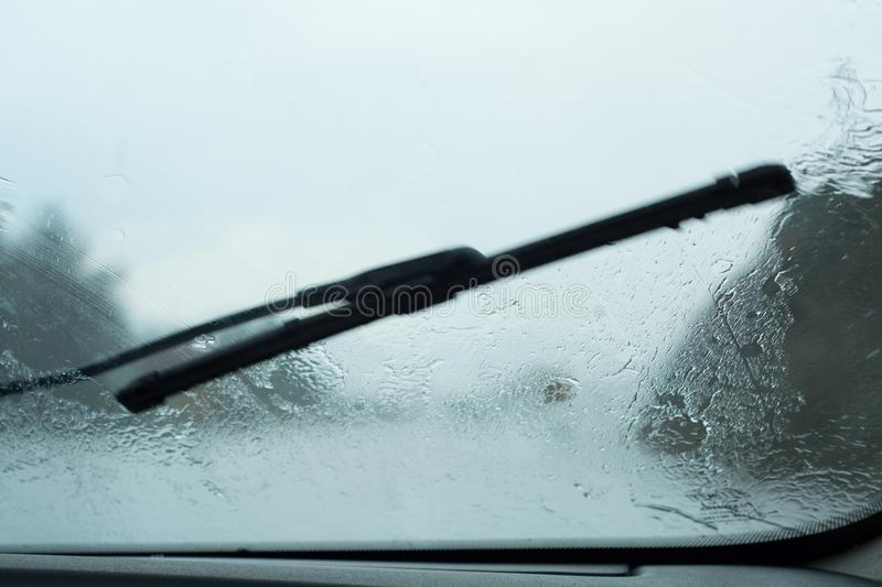 Driver POV Through Raindrop Car. Highway Driver POV Through Raindrop Car Windshield During Rain Storm stock image