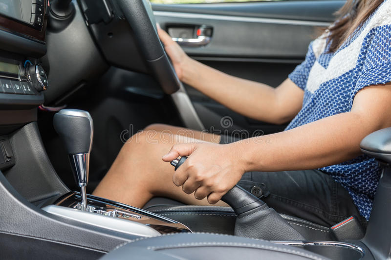 Driver pulling the hand brake in car stock photos