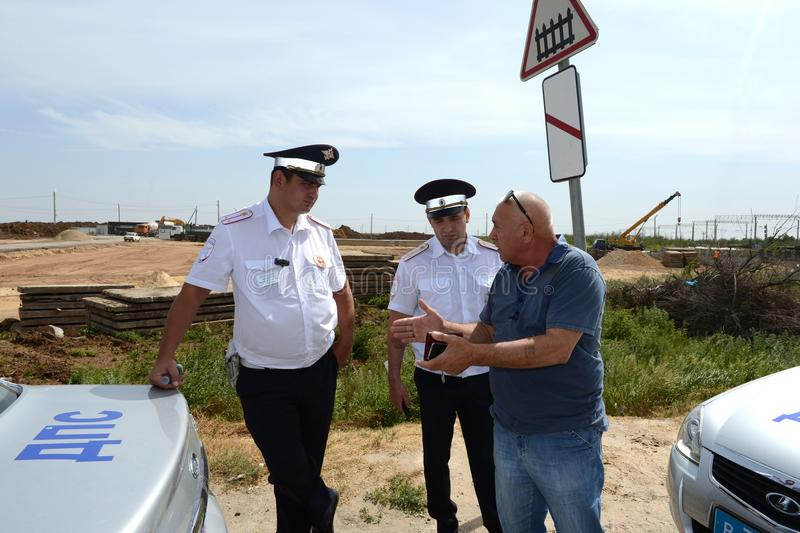 The driver's conversation with the inspectors of traffic police on the roadside. royalty free stock photography