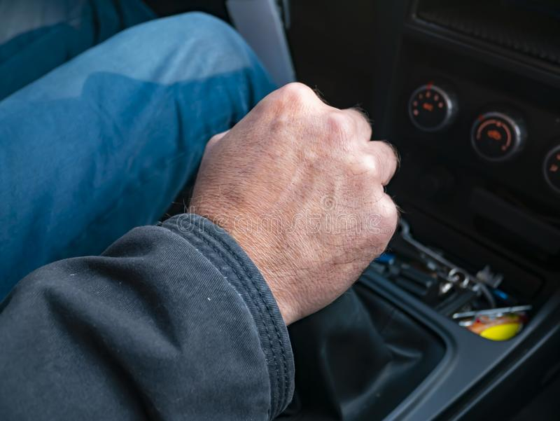 Driver`s hand on gear knob stock photography
